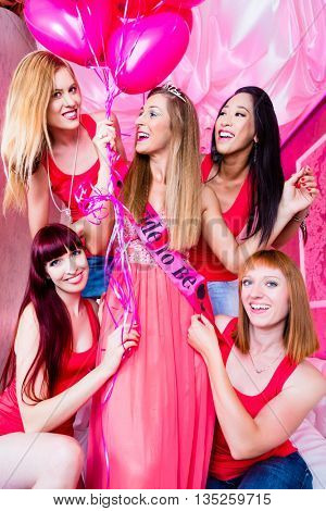 Bride and friends celebrating hen night in club