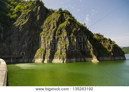 Vidraru Dam on Arges River. Arges Romania. Hydro electric power station on the suothern side of Transfagarasan mountain road