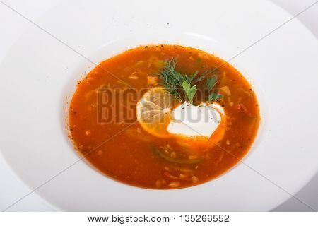 Russian soup with sour cream served in white plate