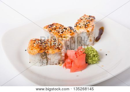 Baked japaneese rolls served with marinated ginger and wasabi