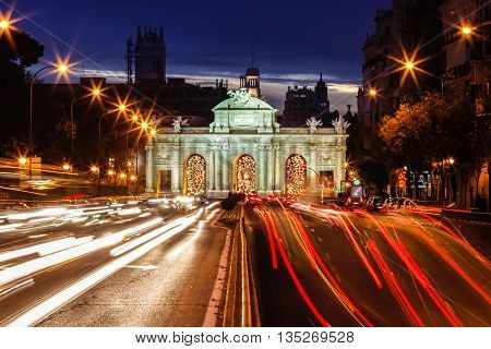 Puerta de Alcala and trafic lights shot at dusk, Madrid, Spain.