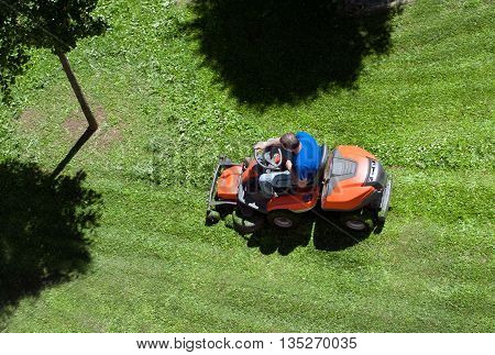 Overhead View Of A Man Mowing The Lawn