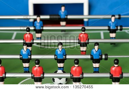 Red And Blue Players In A Table Football Game