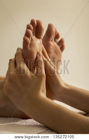 Woman receiving a foot massage at the health spa center