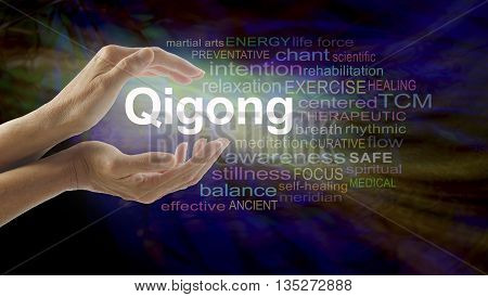 Gigong word cloud and healing hands - female cupped hands with the word QIGONG between surrounded by word cloud on a multicolored light centered dark background