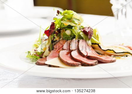 baked meat with salad