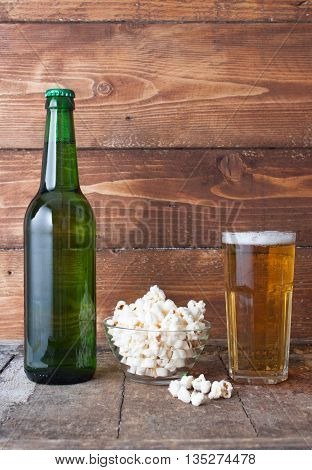 Bottle-glass Of Cold Beer With Popcorn On Wooden Table