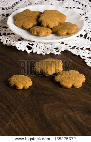 Tasty honey cookies are on wood background.