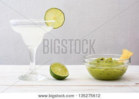 Margarita cocktail on a white wooden table