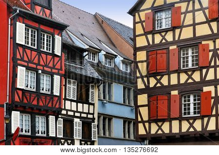 Old half-timbered houses of different colors. Colmar, Alsace, France.