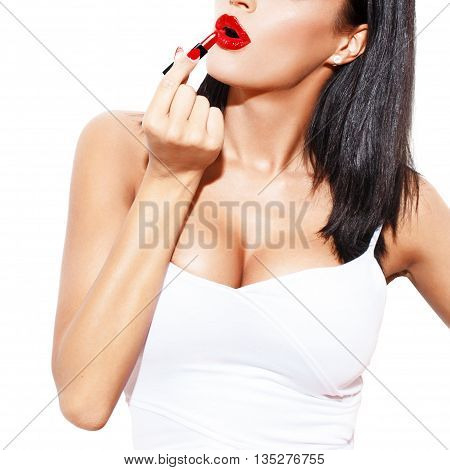 Sexy woman with big tits apply red lipstick isolated on white