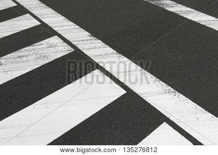 White Zebra Crossing On Cityscape Car Road