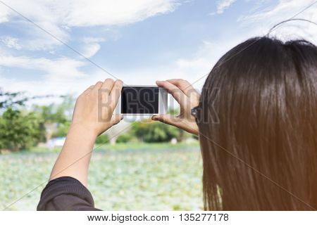 Back Or Rare View Of Girl Or Women Shooting Photo Or Video Via Smartphone In The Park, Girl Or Women