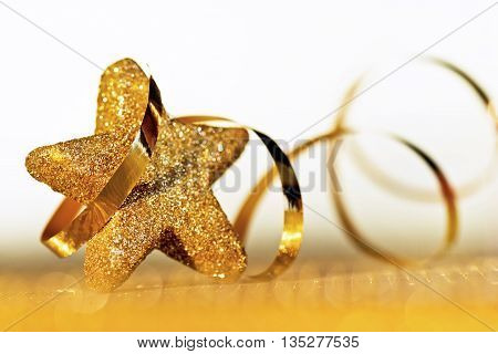 Detail of Christmas star with a ribbon