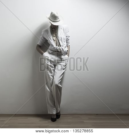 Young adult girl posing at fashion shot in white dress