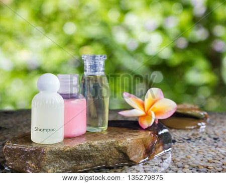 Liquid Soap Gel Bottle Group On Pebble Rock And Water On Gree Nature Bokeh Background In Soft Mood A