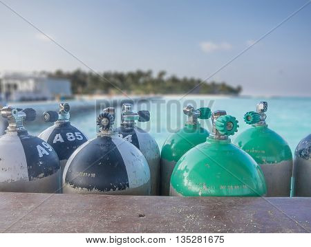 Closeup of immersion tanks on tropical sea background