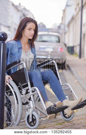 Paralyzed woman using his wheelchair