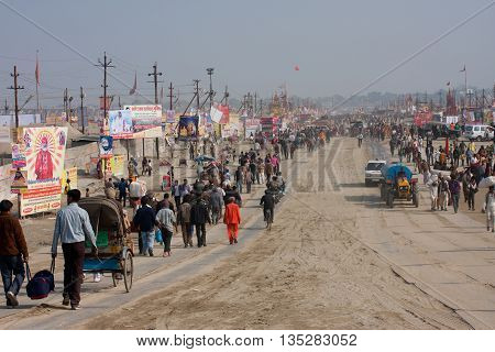 ALLAHABAD, INDIA - JAN 27, 2013: Thousands of people rushing to Sangam during the biggest festival in the world - Kumbh Mela on January 27, 2013 in Allahabad. Mela 2013 had take 130 000000 pilgrims.