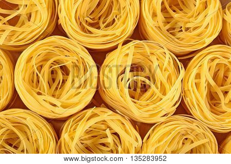 Uncooked Italian Pasta Tagliatelle Nests As Background