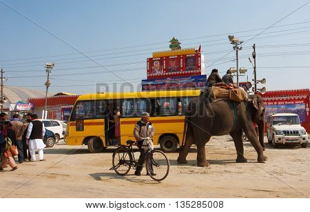 ALLAHABAD, INDIA - JAN 25, 2013: Elephant and the indian people on the bus stop of biggest festival in the world - Kumbh Mela on January 25, 2013 in Allahabad India. Mela 2013 had take 130 000 000 visitors