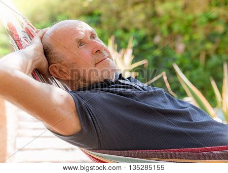 retired man lying down relaxed