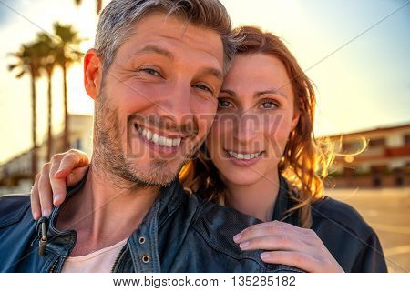 miami couple smiling for selfie