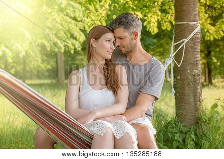 embracing couple together in hammock