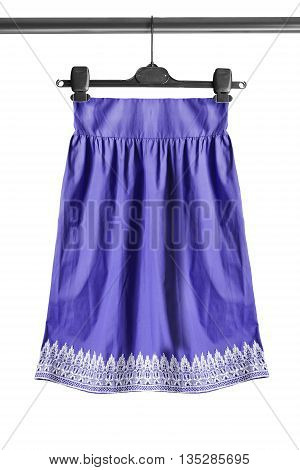 Purple skirt on clothes rack isolated over white