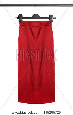 Red skirt on clothes rack isolated over white