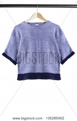 Knitted sweatshirt on wooden clothes rack isolated over white