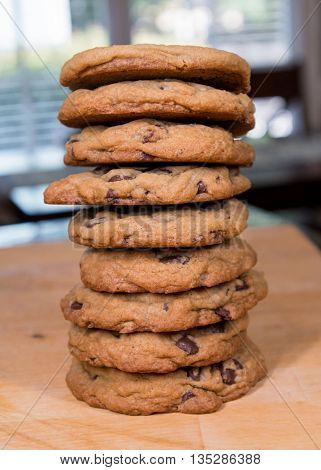 Stack of Giant Chocolate Chip Cookies on butcher block