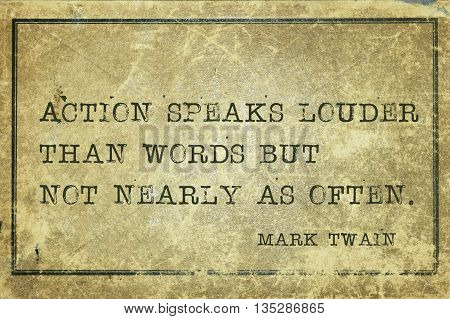 Action speaks louder than words - famous American writer Mark Twain quote printed on grunge vintage cardboard