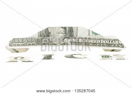 Car origami folded from a hundred dollar bill with a signature at the bottom of word rich carved out of money isolated on white background