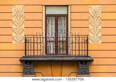 One window and balcony on facade of urban apartment building front view St. Petersburg Russia
