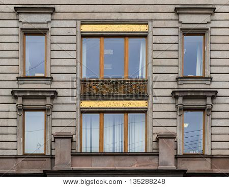 St. Petersburg Russia - May 16 2016: Several windows in a row on facade of Singer House front view