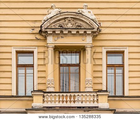 St. Petersburg Russia - May 16 2016: Three windows in a row and balcony on facade of urban office building front view