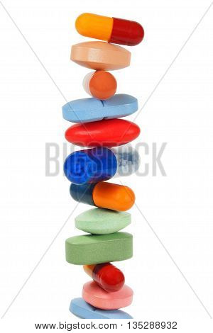 High stack of pills isolated on white background
