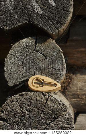 iron jew's-harp in lumber box near old wall close up
