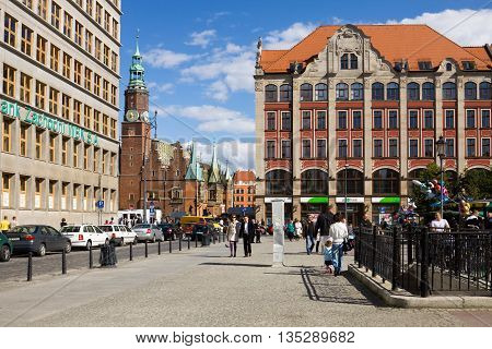 WROCLAW POLAND - SEPTEMBER 05 2010: The Plac Solny (Salt square) in Wroclaw Poland. The square is situated in the old town of Wroclaw near the popular Market square. The city hall on the Market square is seen in a space between the houses.