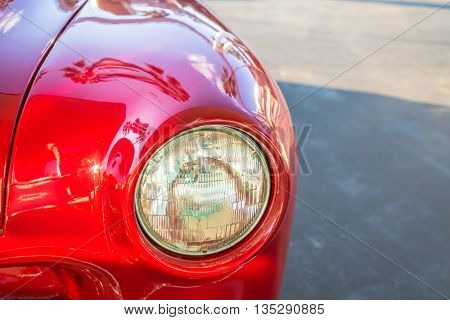 Headlight of a vintage car( Filtered image processed vintage effect. )