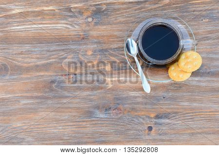 wooden background with coffee and biscuits with the space for your text
