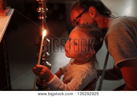 Mother and little daughter in Church. Cyprus