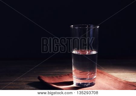 Glass of pure water on wooden table