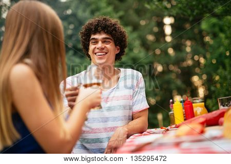 Couple toasting together during the lunch with friends.