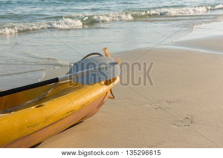 The empty yellow kayak on the beach ready for paddler. Suitable for use as wallpapers.