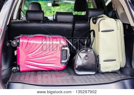 Suitcases and bags in trunk of car ready to depart for holidays.