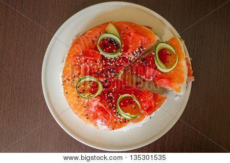 Salmon Sushi Cake with nigiri, soy sauce, cucumber, salmon, avocado, caviar, nori sesame Top view