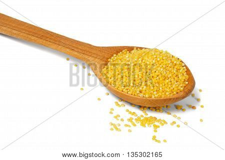 Wooden spoon with millet on white background