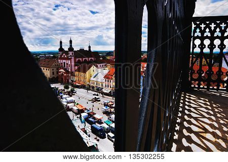 2016/06/18 Chomutov city Czech republic - square 'Namesti 1. Maje' with the church 'Kostel sv. Ignace' from the railing of the tower during the farmer's markets
